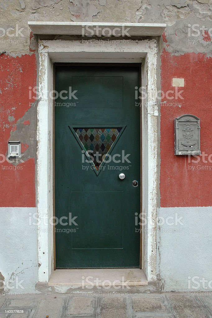 Green door in Murano, Italy stock photo