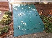 a green door leading into a basement or cellar
