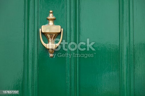 Close up view of green door with brass knocker. Taken with Canon 5D Mark2