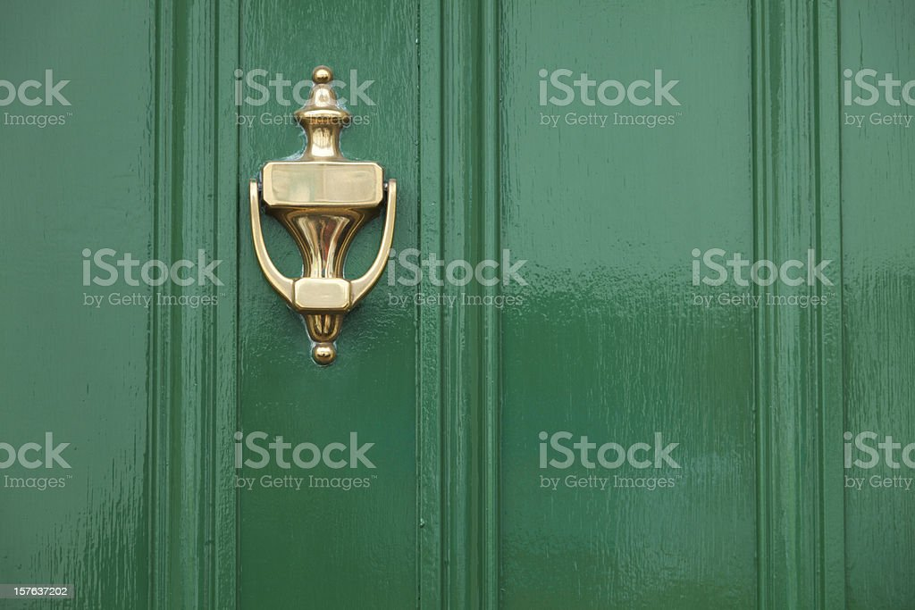 Green Door With Brass Knocker stock photo