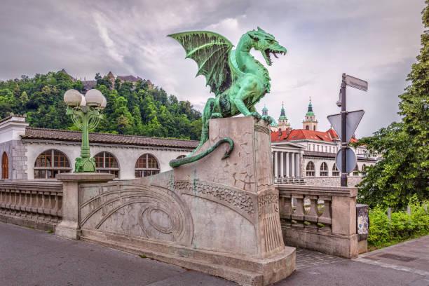 Green Dragon on Zmajski Most bridge in Llubljana, Slovenia Green Dragon on Zmajski Most bridge in Llubljana, Slovenia ljubljana stock pictures, royalty-free photos & images