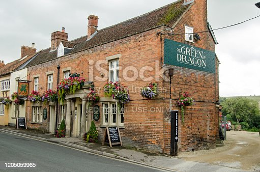 Wiltshire, UK - August 17, 2019: The historic Green Dragon public house in the village of Market Lavington in Wiltshire, England.