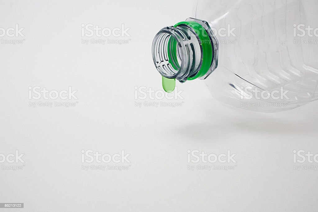 A green droplet on a plastic bottle royalty-free stock photo