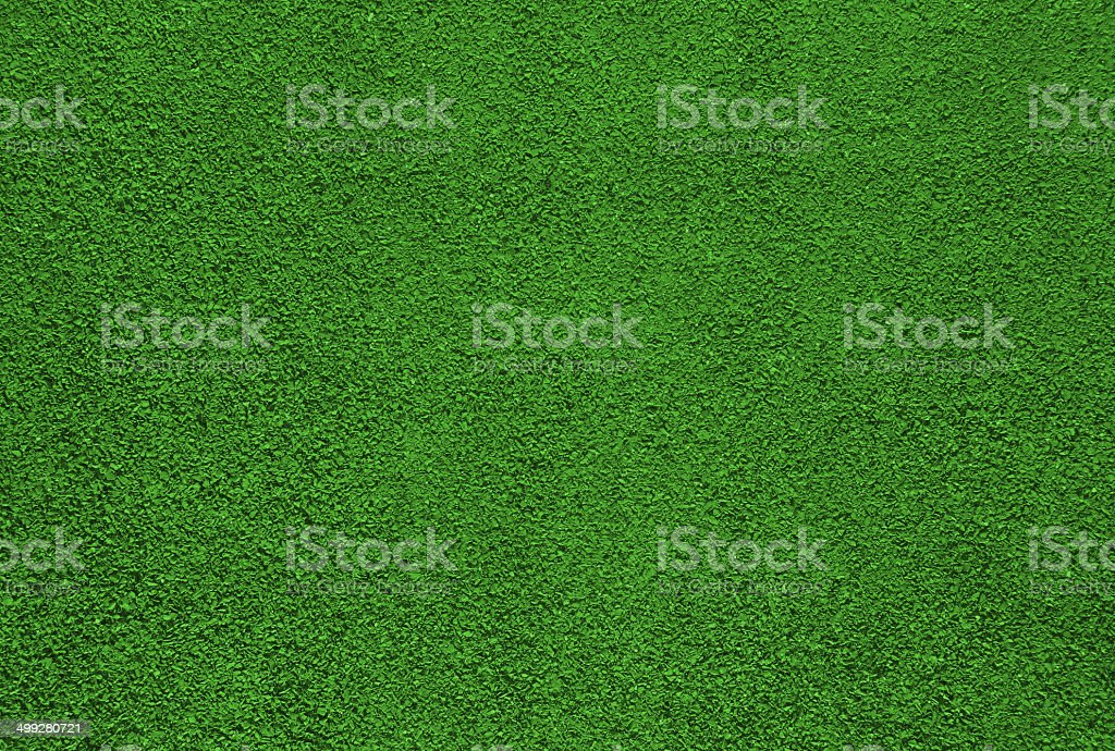Green dry grungy clay tennis, soccer, football background texture. stock photo
