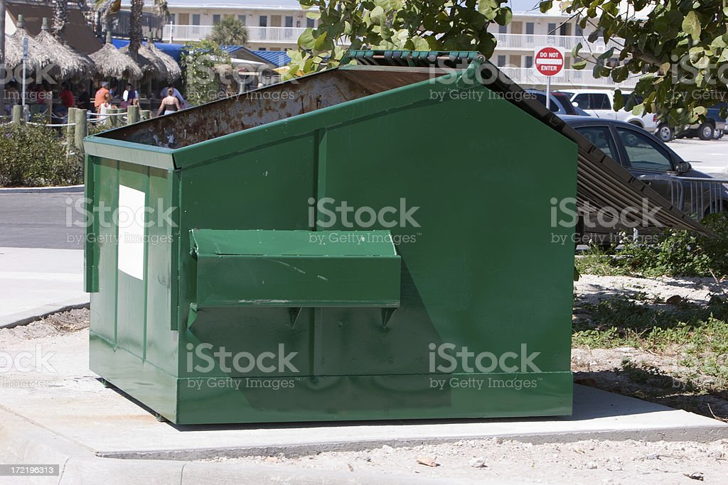 Green Dumpster stock photo