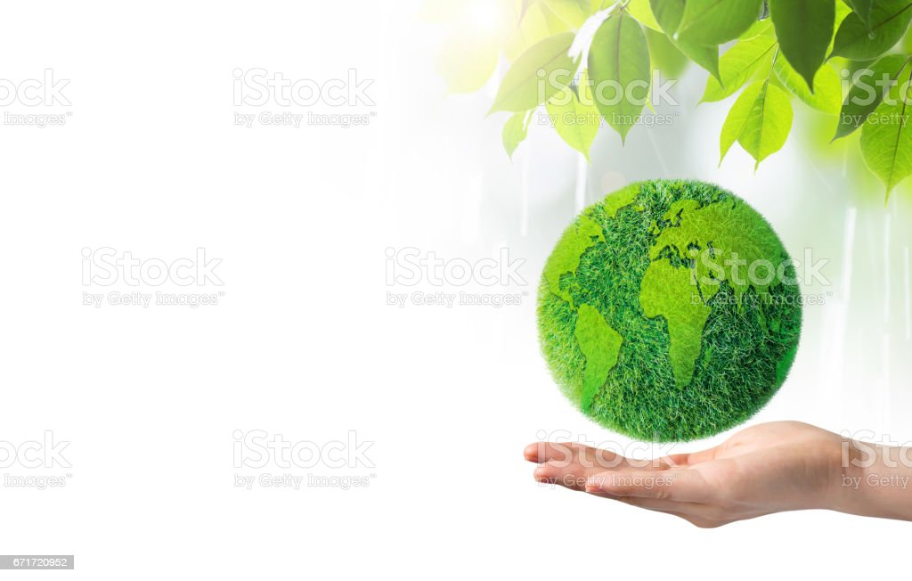 Green earth in hand on white background stock photo