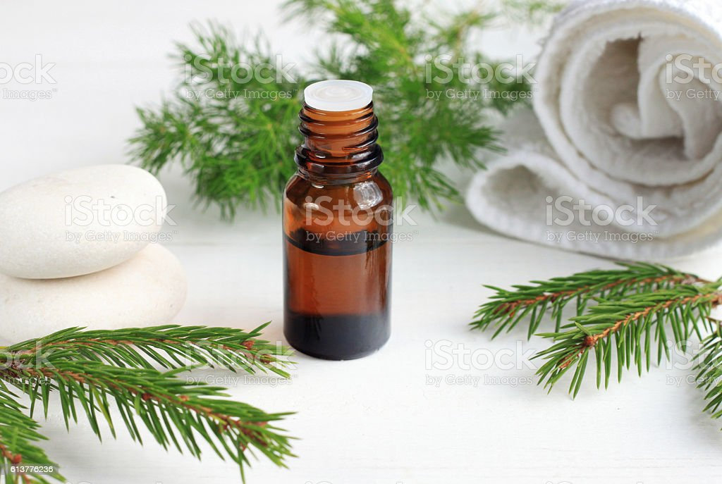 essential oil, aromatic pine twigs, white towels. Relaxing beauty...