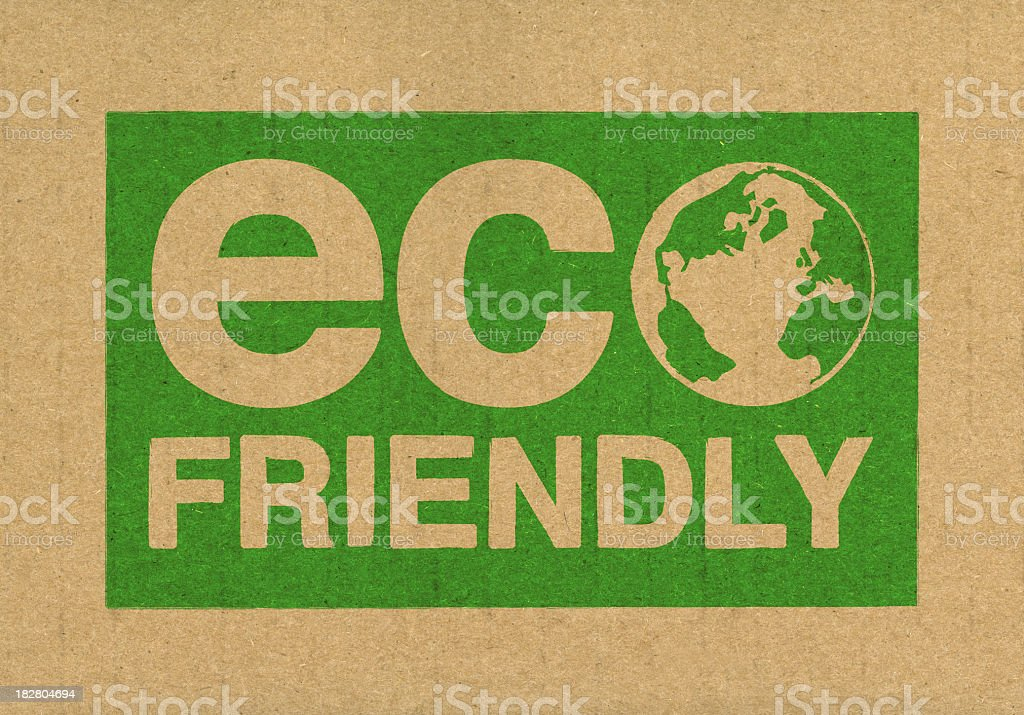 A green eco friendly symbol on brown cardboard stock photo