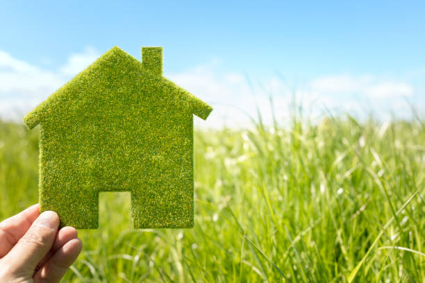Green eco house environmental background stock photo