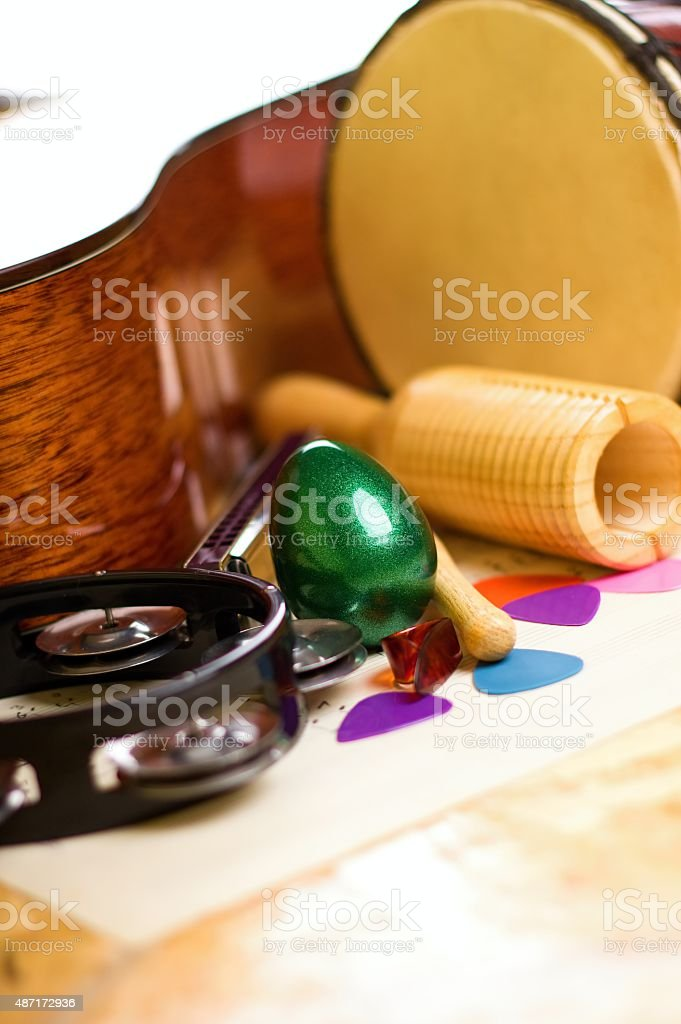 Green egg shaker among other instruments stock photo