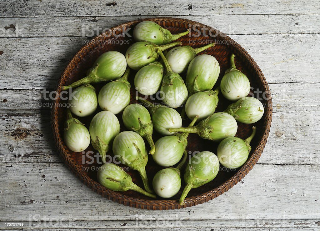 green eggplants ,Cockroach Berry  in the threshing basket royalty-free stock photo