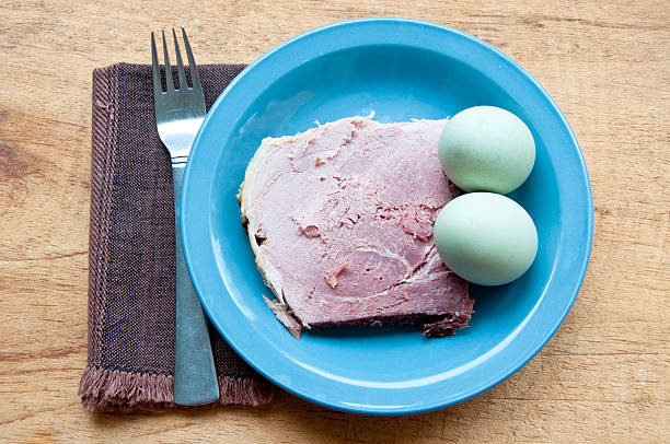 Green eggs and ham with fork, napkin stock photo