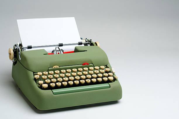 Green Electric Typewriter with Blank Paper stock photo