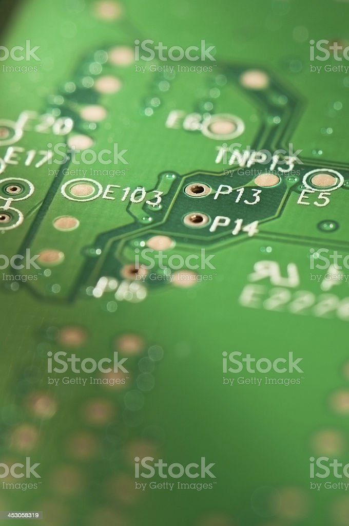 Green electrical circuit board with components royalty-free stock photo