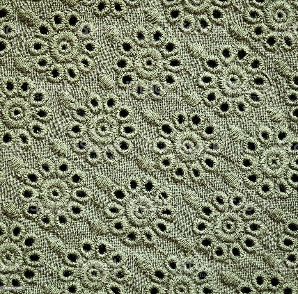 Green embroidered fabric royalty-free stock photo