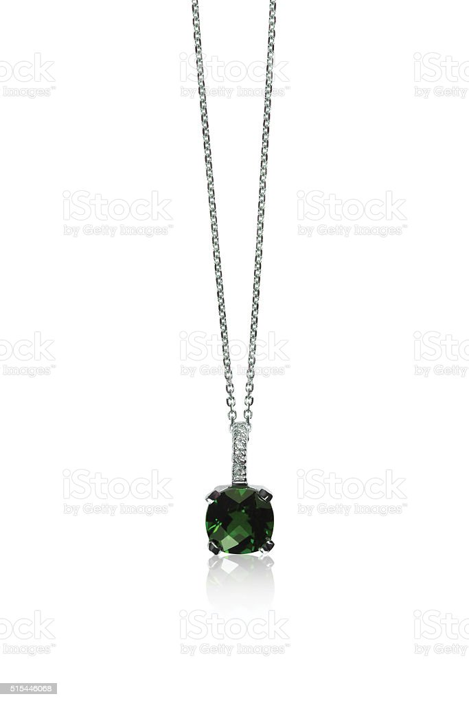 Green Emerald Gemstone Pendant Necklace Green Gemstone Pendant Necklace isolated on white Anniversary Stock Photo