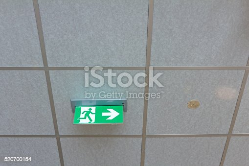 istock Green emergency exit sign. 520700154
