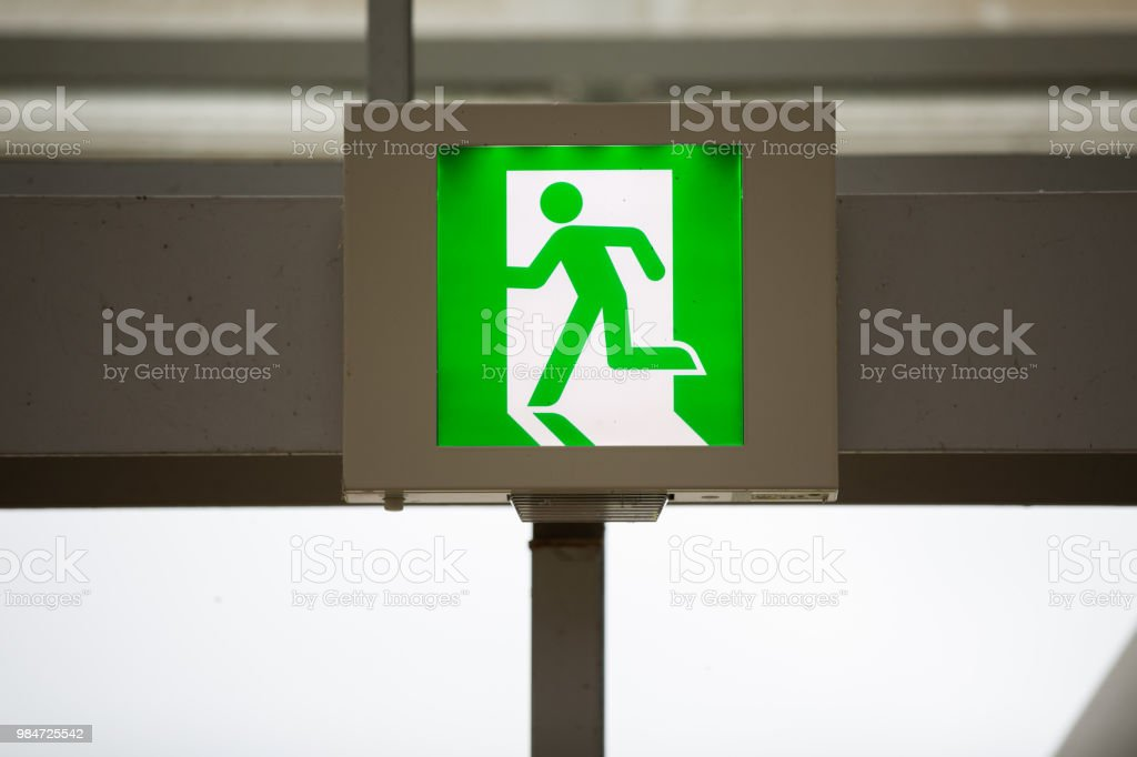 green emergency exit sign. stock photo