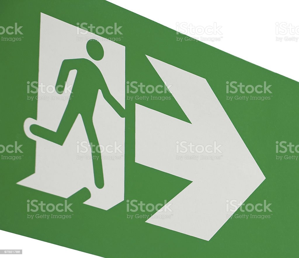 Green emergency exit sign with running figure stock photo