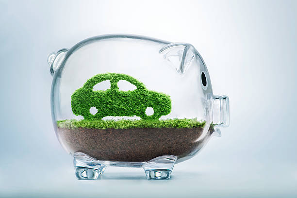 Green energy car Green energy concept with grass growing in shape of car inside transparent piggy bank alternative fuel vehicle stock pictures, royalty-free photos & images