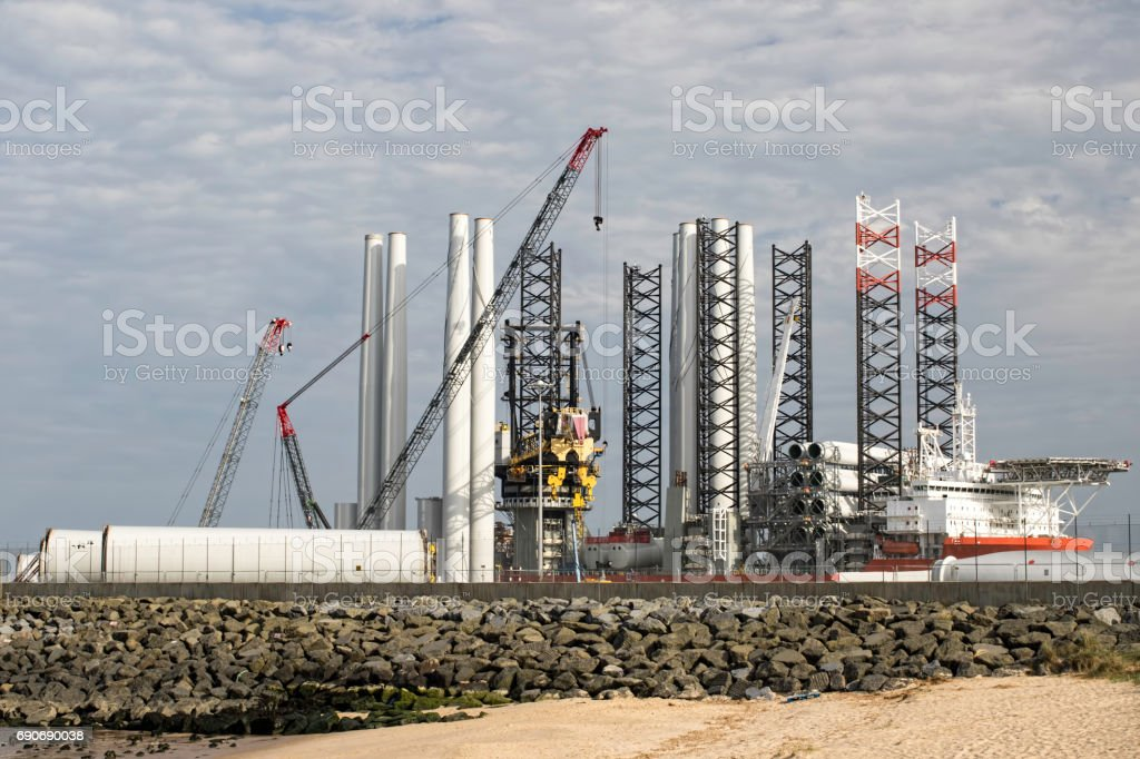 Green energy investment. Port supplying turbine parts for offshore wind farm construction. stock photo