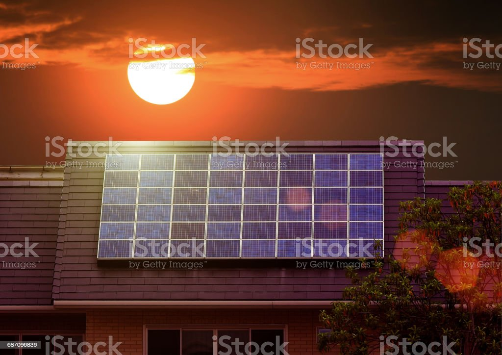 Green energy of solar cell panel on house roof stock photo