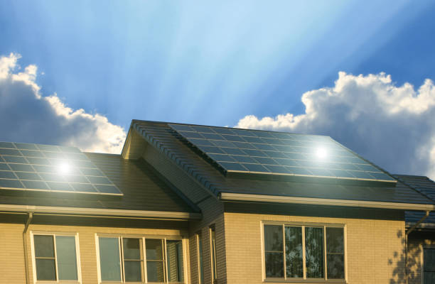 Green energy of solar cell panel on house roof Green energy of solar cell panel on house roof in blue sky and sunlight solar panels photos stock pictures, royalty-free photos & images