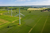 Wind turbines that produce electricity, built on a field in Skanderborg, Denmark