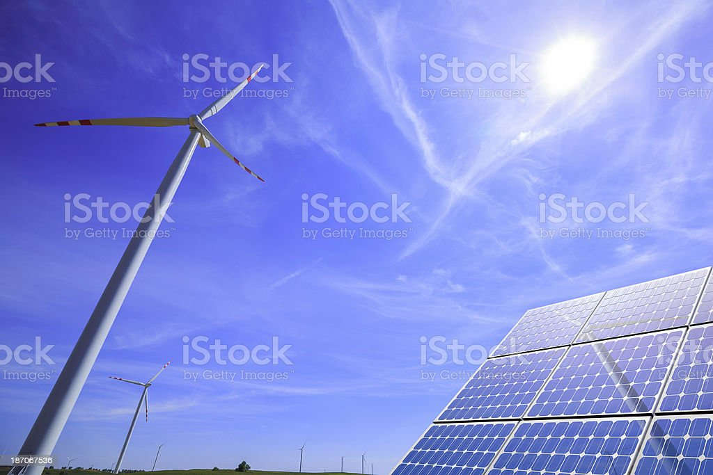 green energy: wind turbines and modern solar panels royalty-free stock photo