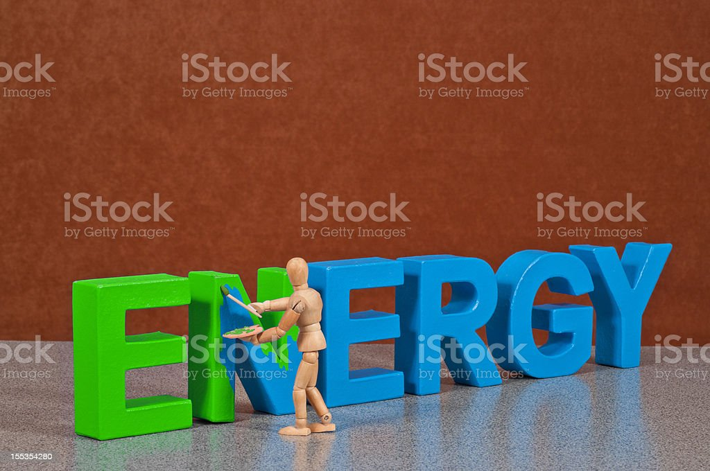 green Energy - Wooden Mannequin demonstrating this word stock photo