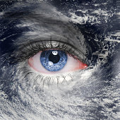 blue eye in the middle of a tropical hurricane. Elements of this image furnished by NASA