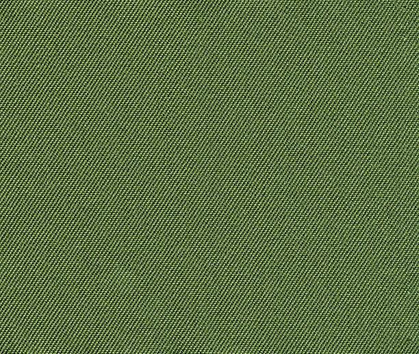 grüne stoff hintergrund - textilien stock-fotos und bilder