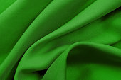 istock Green fabric texture for background and design, beautiful pattern of silk or linen. 1093896048