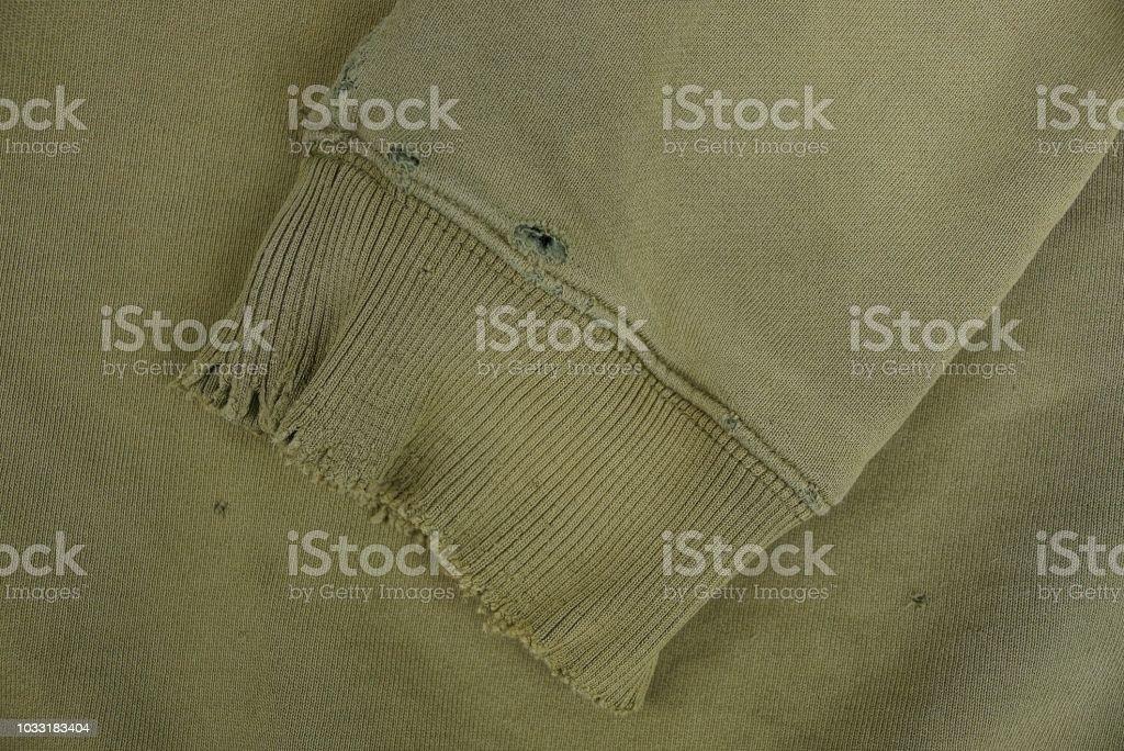 不規則な古着のワンピースの袖付き緑の布テクスチャ ストックフォト