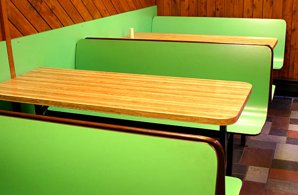 green fast food restaurant booth stock photo