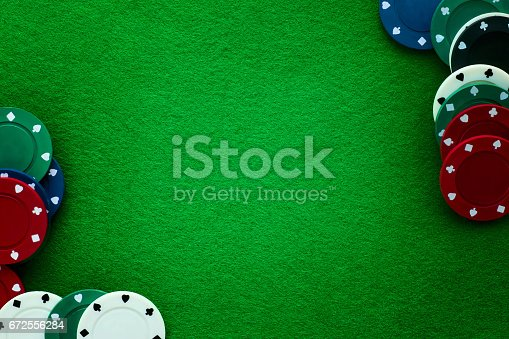 istock Green felt and playing chips abstract background. 672556284