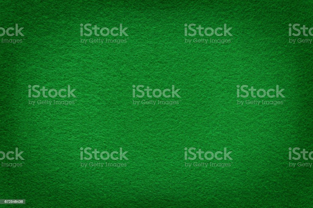 Green felt surface with light copy space in center stock photo