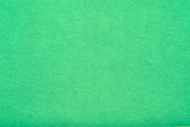 grün filz textur abstrakte kunst hintergrundfasern - schichthaare stock-fotos und bilder