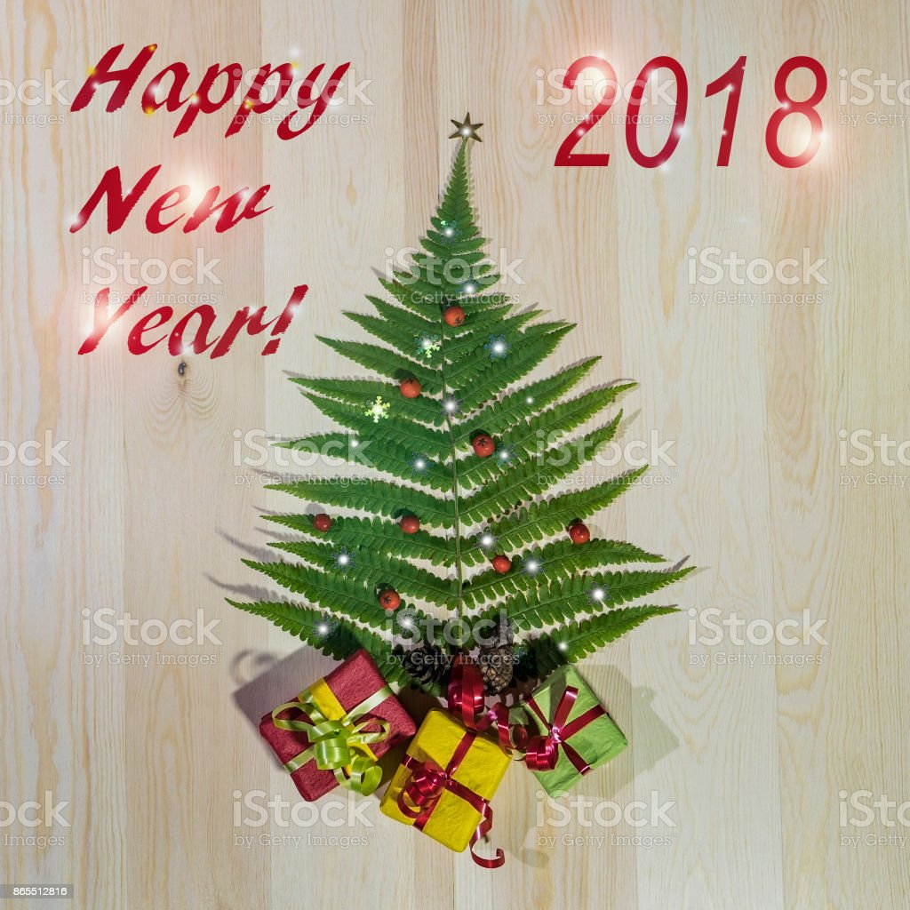 Green Fern Leaf Like A Christmas Tree With Gifts Stock Photo More