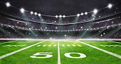 istock green field in american football stadium. ready for game in the midfield 1245928482