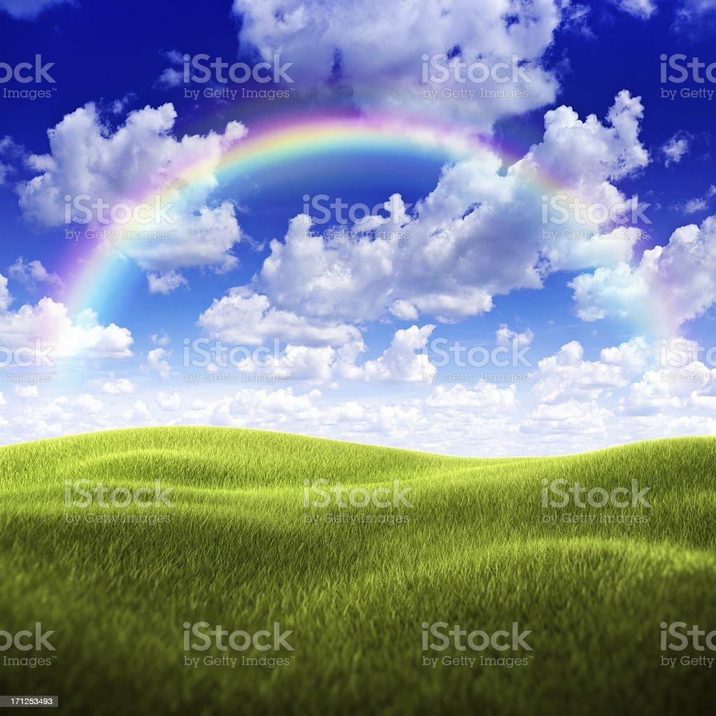 Green field over moody sky and rainbow royalty-free stock photo
