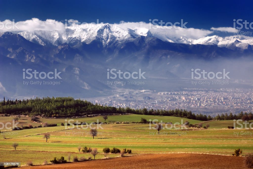 Green Fields and Snowy Mountains, Denizli, Turkey stock photo