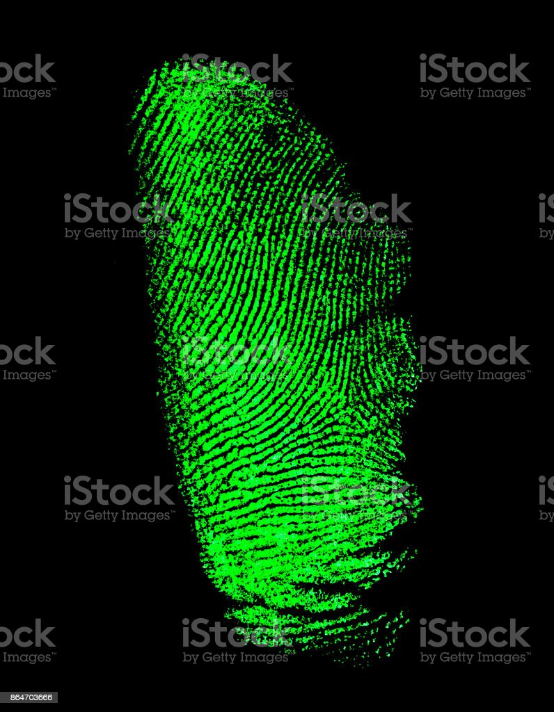 Green fingerprint on black background stock photo