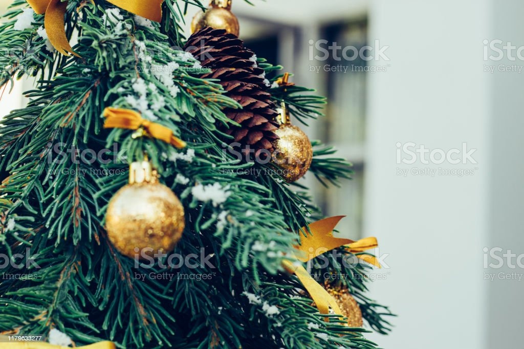 Green Fir Tree With Golden Balls Christmas Wallpaper Stock Photo Download Image Now Istock