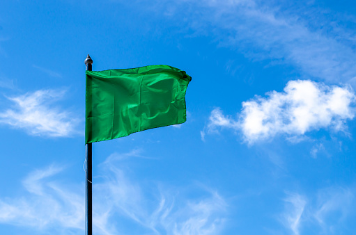 Green Flag And Sky