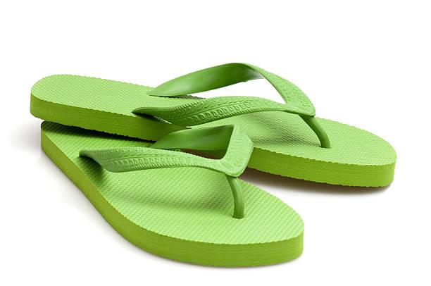 905fcea7d4fb06 green flip-flop stock photo