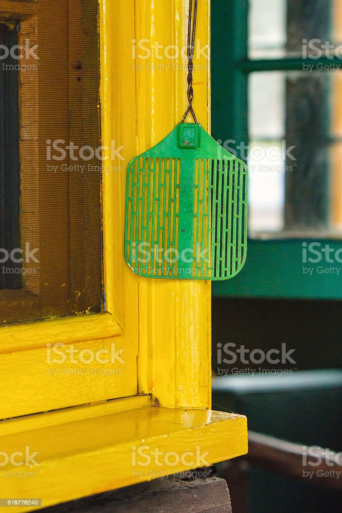 Green Fly Swatter by Yellow Window stock photo