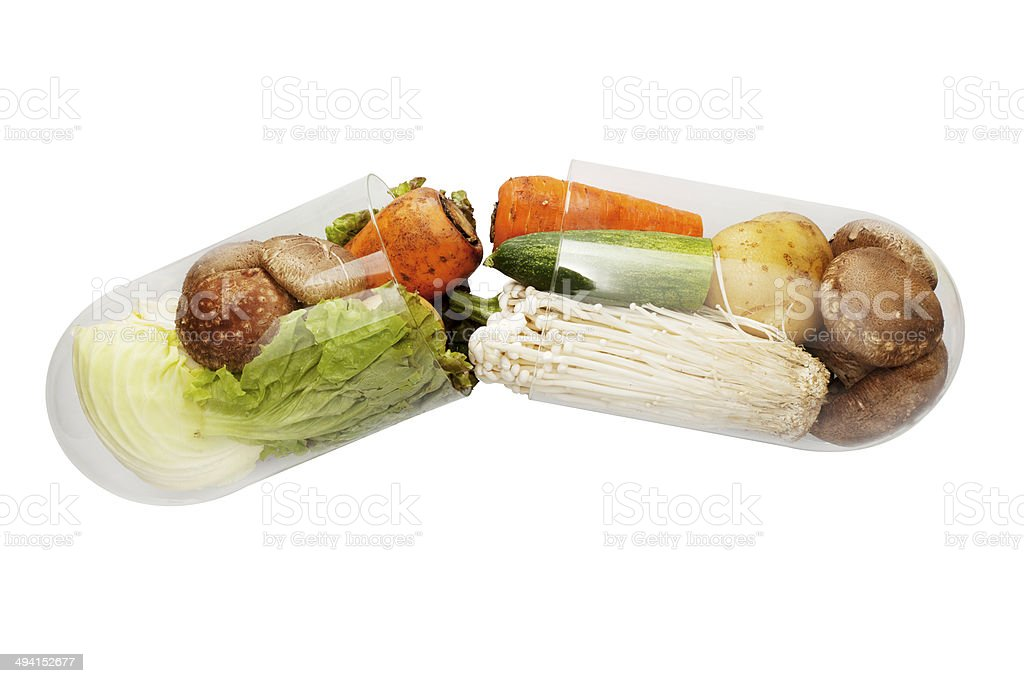 green food capsule stock photo