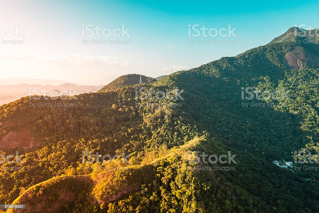 Green forest with mountains around the city aerial view, Brazil stock photo