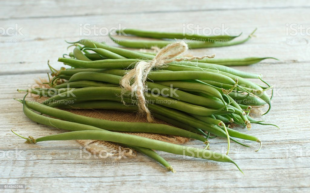 Green french beans on wood stock photo